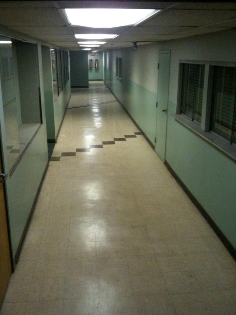 hospital basement, basement, fluorescent light, flickering overhead light, dark basement, dark workplace